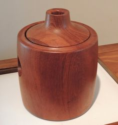 This spectacular staved teak ice bucket is a rare and definitive mid-century Henning Koppel design, with three circles -- lid and sides -- unifying the piece. Marked clearly Georg Jensen, Henning Koppel, and Made in Denmark.   eBay!