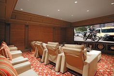 An ideal place to relax with friends, the home theater comfortably seats eight people.