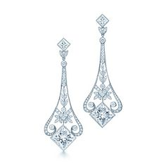 Tiffany and Co. Garland chandelier earrings of princess-cut and round diamonds in platinum. (=)
