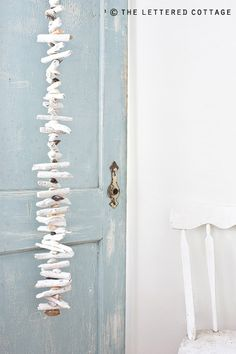 driftwood garland - photo by @TheLetteredCottage