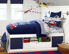 I think the quilt is a bit much, but I love the sheets and firetruck throw pillow as a room inspiration