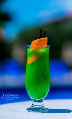 """Its a cocktail tailored for Philoxenia Bungalows..... Hence the name of it Inspired from its green character and the nature that surrounds it! Its """"Philoxenia Bungalows Cocktail"""" #Gin #Lime #OrangeJuice #BlueCuracao  #Saturdays_Countdown #Philoxenia_Bungalows #cocktail #night #cocktailoftheday #favorite"""