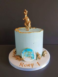 Baby's first birthday in blue, with a contrast of gold Dinosaur figures.  Order from cake. for events in Shoreham-by-Sea, Brighton... Dino Cake, Baby First Birthday, Brighton, First Birthdays, Contrast, Events, Sea, Cakes, Desserts
