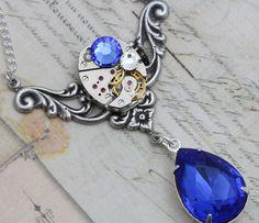 Steampunk Jewelry Blue Sapphire Steam Punk Necklace - Clockwork Vintage Watch Movement - Handmade by Inspired by Elizabeth. $49.50, via Etsy.