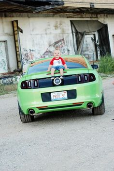 LiL Mustang Fan in the making :) Sitting on Mommy's 2013 5.0 Mustang Picture taken by Janelle Reed Photography