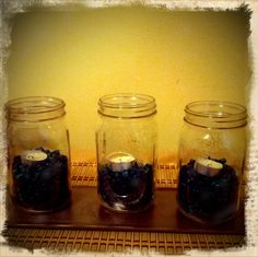 Mason Jars + tea lights + fish rocks! (great idea A.J)