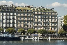 Positioned on the shore of Lake Geneva, with exceptional views of the city's famous Jet d'Eau and Mont Blanc as a timeless backdrop, Hotel de la Paix has defined luxury in Geneva since its inception in 1865. It has also stood at the crossroads of history, inspiring many memorable gatherings including the International Congress of Peace, and has welcomed high-profile guests from across the globe, such as the Monaco Royal Family and notable American actor Orson Welles. The Crossroads, Monaco Royal Family, Orson Welles, Lake Geneva, American Actors, Switzerland, Jet, Globe, Backdrops