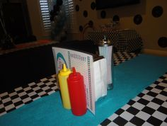Diner complete with ketchup, mustard, napkin dispenser, straw caddy, and handmade diner menu.