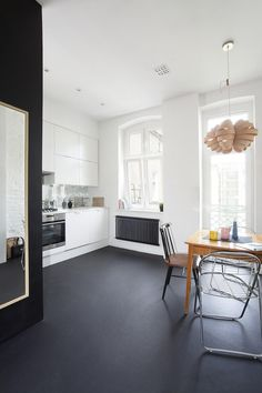 Black painted concrete floor for a white kitchen - I'd like my garage floor to be black like this.