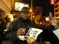Samuel L. Jackson signing autographs at the stage door of the Bernard B. Jacobs Theatre
