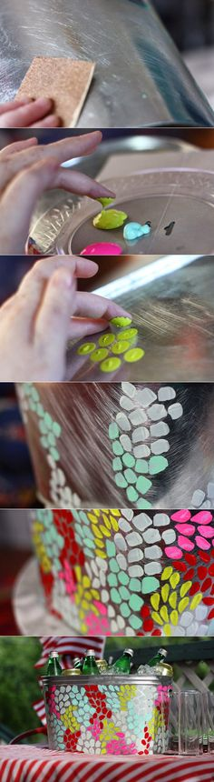 Use fingerprints and paint to decorate metal tub. Love this for a boring looking trash can!