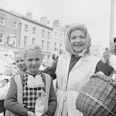 Ireland This woman is one of the most vibrant portraits in our collections. The girl with her in the check dress appears in another Wiltshire shot, taken in Moore Street, Dublin on the same day. Photographer: Elinor Wiltshire Date: 1964 Mystery Shopper, Dublin City, Family Genealogy, 1960s, Ireland, Check Dress, Women, Vibrant, Basket