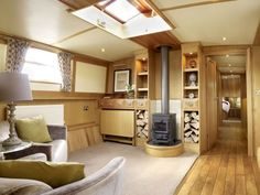 Comfortable Saloon with stove to complement the central heating, and a pigeon box lets in additional light from above.