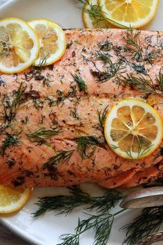 NYT Cooking: This simple fish dish is best made with wild salmon, but it works equally well with the farmed sort. It's astonishingly easy. In a hot oven, melt butter in a skillet until it sizzles, add the salmon, flip, remove the skin, then allow to roast a few minutes more. You'll have an elegant fish dinner in about 15 minutes. Don't be afraid to play with herb and fat ...