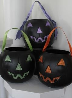 Pimp your dollar store jack o'lanterns with glitter and ribbon..fun for trick or treating!