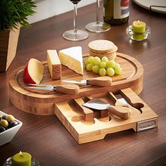 Hardwearing 100% natural bamboo wood oval shaped board with concealed slide out storage tray Includes stilton knife, cheddar knife, hard cheese knife and cheese fork - all with strong stainless steel blades and smooth bamboo handles Suitable for both cutting and serving - the perfect centrepiece for parties and entertaining Board size: 14 (L) x 7.8 (W)