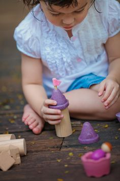 A wooden castle block set made from sustainable rubber wood from Plan Toys.