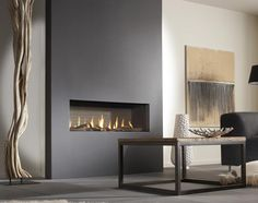 Hole in the wall fire, this simple gas fire with logs, brings a warm contemporary look to any room