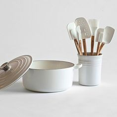 Perfect wedding or bridal shower gift. White Le Creuset cookware set with matching spatulas.