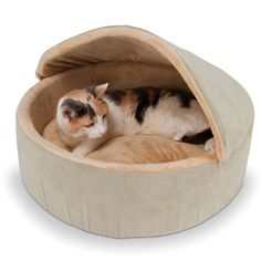The Warming Cat Bed - Hammacher Schlemmer - Recommended by veterinarians, this bed generates a gentle warmth to soothe older or arthritic pets.