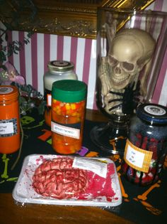 Gross! display for Halloween.  Repurposed cans and jars filled with candy.  Candy Corn is witches toenails