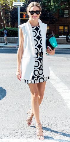 Olivia Palermo took her front-row savant at Desigual in a black-and-white concentric circle-print dress, giving it her signature Palermo-approved spin with a sharp white waistcoat, a black skinny belt, studded shades, a seagreen Roland Mouret purse and nude lace-up Aquazzura sandals. #InStyle