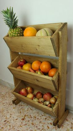 A rustic, market-style stand for storing fruit is a great addition to any kitchen. For this fruit holder you'll need wood pieces of specific sizes, as shown, along with a drill, jig saw, screws and wood stain