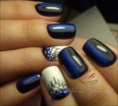 Gorgeous dark blue and white peacock nail art design