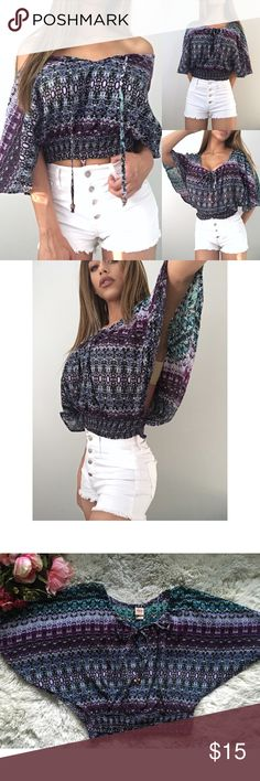 3 way cropped blouse floral tribal print This crop top can be worn 1. off the shoulder 2. Tied loosely as a low scoop neck 3. Tied tight. The end of the strings have wooden beads. The sides have a long slit. A bandeau isn't a necessity since it isn't super visible when wearing because the shirt is so flowy. EUC Mossimo Supply Co Tops Crop Tops