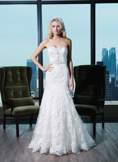 Justin Alexander Signature Wedding Dresses Style 9771 Embroidered lace fit and flare dress featuring a sweetheart neckline.