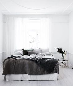 Keep it clean, simple, white - but must have is a big, fat bed