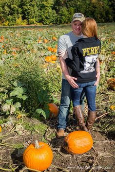 fall engagement photography blake's apple orchard armada, michigan photographer Paul Retherford photography #appleorchard #pumpkinpatch #engagement #michiganengagement #michiganphotographer #blakesappleorchard #blakes #cidery #pumpkin #apple #fallengagement #fall #paulretherford #military #militaryengagement