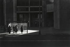 """City Whispers: Philadelphia, 1981 : Ray K. Metzker (1931 – 2014) was an American photographer known for both his work in cityscape and landscape photography and for his large """"composites"""", assemblages of printed film strips and single frames. His work is held in various public collections, he is the subject of eight monographs and received awards from the John Simon Guggenheim Memorial Foundation, National Endowment for the Arts and Royal Photographic Society."""