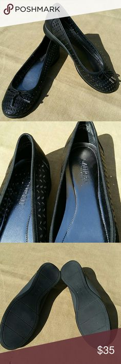 EUC Ralph Lauren NIA slip on loafers with cutouts Very comfy and true to size.  Stle name is NIA.  Solid black, except the little silver pieces as shown in 2nd pic.  Barely worn once.  Excellent condition. 100% goat leather upper.  20% PU/80% pig leather lining. Lauren Ralph Lauren Shoes Flats & Loafers
