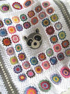 Crochet raccoon baby blanket. So cute!