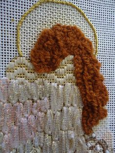 Needlepointing in your Nest  This angel's hair is pretty using Lorikeet and the sorbello stitch from Meredith Willett's book, Knots, Fur, and Turkey Work. Here, Dr. Mia did it in vertical rows by turning her angel sideways.