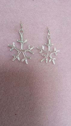 These are great winter earrings and super for those that like Frozen. The snowflakes are made of Silver Plated Silver wire and hang about 1 1/2 inches. Remember - no two snowflakes are alike so each is unique. $10 #W006  JewelryArtByLinda@gmail.com