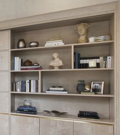 Bookshelf detail from luxury interior design studio 1508 London at Park Crescent property. Bespoke shelving features flush brass detailing.