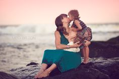 Beautiful nursing mama with baby and little girl. Meg Bitton