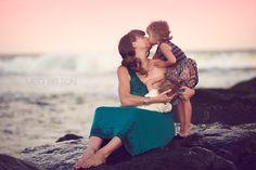 Beautiful nursing mama with baby and little girl. Meg Bitton