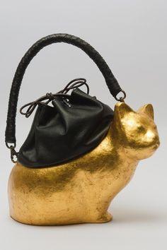 Gold cat bag.