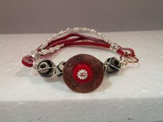 Stamped copper bracelet size Medium,  freshwater pearl, plated beads, focal piece of stamped copper disc, black/white glass beads, red coral