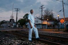 The Rev. Victor White at the railroad tracks that divide New Iberia. - Ruddy Roye for The New York Times