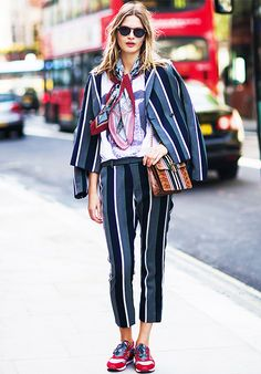 Matching pantsuit set, graphic t-shirt, and silk scarf