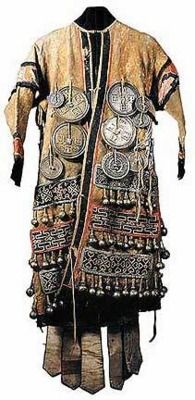 Mongolian Shaman's coat. Note all the bells, bells are a feature found in Siberian Shamanism also. Oriental bells are often made differently than Eurasian ones, but these bells are also seen in the Birka Iron Age Sweden site.