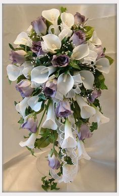 Cascading bouquet with white calla lilies and lavender roses. Weddings should be a reflection of your personal style, and at H&J Florist we try to show what you love through flowers, texture, color, and style. Give us a call for all your floral needs, to speak with someone about a wedding please try to call at least a week in advance so we may be sure to have someone here to speak with you. Give us a call at  269-429-3621.