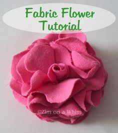 "fabric flower...this is the popular quarter-fold, but with a variation: a little rolled ""bud"" center. Cute!"