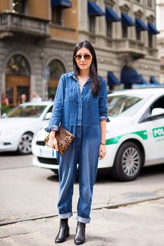 Say yes to a denim jumpsuit. Add contrast with a printed clutch. // #Denim