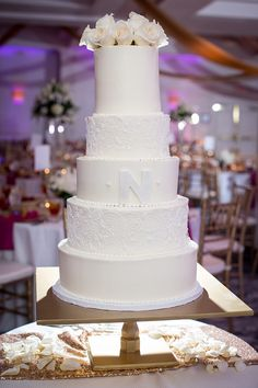 Simple and elegant white wedding cake by Cheesecake Etc