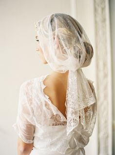 Love the swept-up hair and veil.